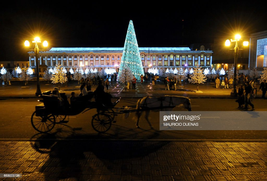 Bolivar square is illuminated with Christmas Lights on December 4, 2008, in Bogota. AFP PHOTO/Mauricio DUEÑAS /