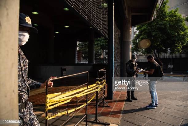 Bolivarian National Police check credentials of people in empty Chacao Subway Station as a preventive measure against the new type of coronavirus...