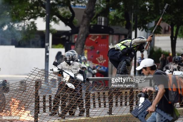Bolivarian National Police disperse protesters during a rally against the government of President of Venezuela Nicolas Maduro at La Carlota Air Base...