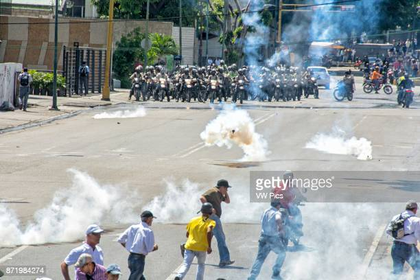 Bolivarian National Police lashes out against protesters with tear gas in the streets near the highway Opponents marched to the Ombudsman's Office...