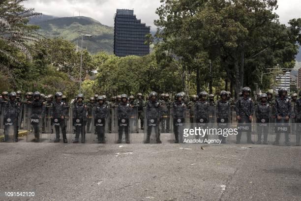 Bolivarian National Police officers stand guard in front Universidad Central de Venezuela during opposition protest against President of Venezuela...