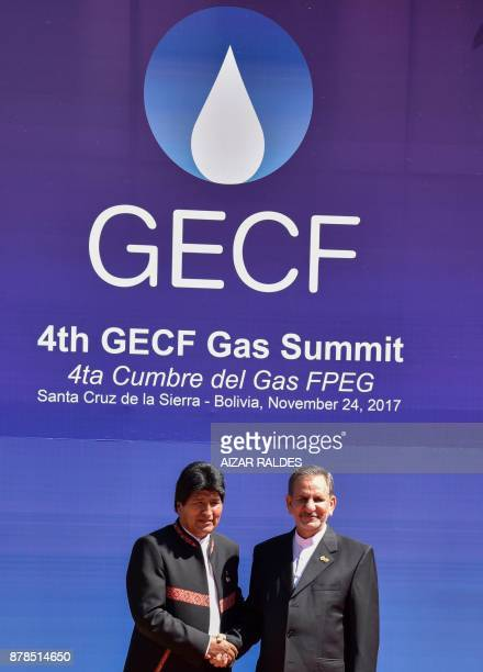 Boliva's President Evo Morales shakes hands with Iranian VicePresident Eshaq Yahanguiri during the IV Gas Exporting Countries Forum summit in Santa...