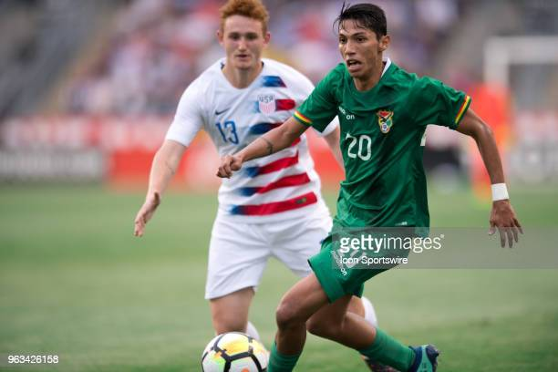 Bolivia Forward Hector Ronaldo Sanchez gathers the ball on defense to keep it from US Forward Josh Sargent in the first half during the Friendly...