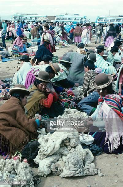 Bolivia, nr Palcoco, Aymara Indian women trading wool at market