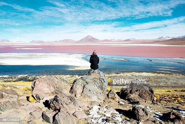 Bolivia, Potosi, Woman admiring Laguna Colorada