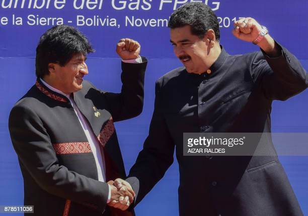 Bolivia President Evo Morales shakes hand with his Venezuelan counterpart Nicolas Maduro during the IV Gas Exporting Countries Forum Summit in Santa...