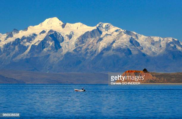 Bolivia, South America, sunset on the volcano Illimani under snow and the Lake Titicaca