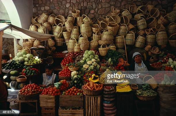 Bolivia Sucre Market stall selling fruit vegetables and locally made baskets