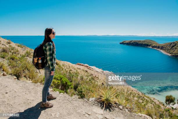 Bolivia, Titicaca lake, Isla del sol, woman with backpack enjoying the view