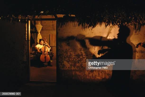 Bolivia, Urubicha, members of orchestra practising inside house, night