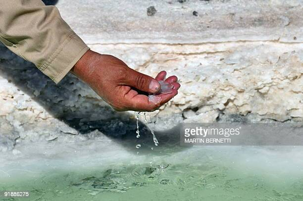 Bolivian engineer Marcelo Aguirre shows brine from a pool at the Uyuni Salt Flats in Bolivia October 10 2009 The Uyuni Salt flats has one of the...