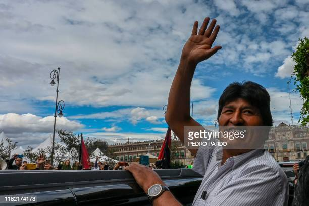 Bolivian ex-President Evo Morales waves as he leaves the Historic City Hall where he was honored as Distinguished Guest by Mexico City's Mayor...