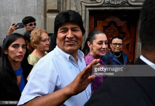 Bolivian exPresident Evo Morales waves upon arrival at the Historic City Hall where Mexico City's Mayor Claudia Sheinbaum will honor him as...