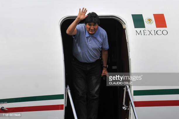 Bolivian ex-President Evo Morales waves upon landing in Mexico City, on November 12 where he was granted asylum after his resignation. - Landlocked...