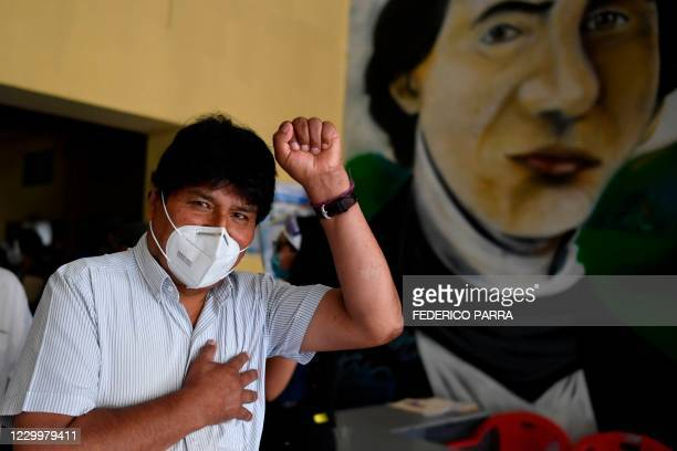 Bolivian ex-president Evo Morales wearing face mask, gestures during a visit to a polling station in downtown Caracas, on December 6 during...