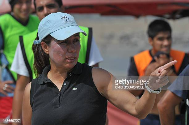 Bolivian football coach Nelfi Ibanez gives instructions to players during a team practice on the beach in Lima on March 21 2012 Ibanez leads the...