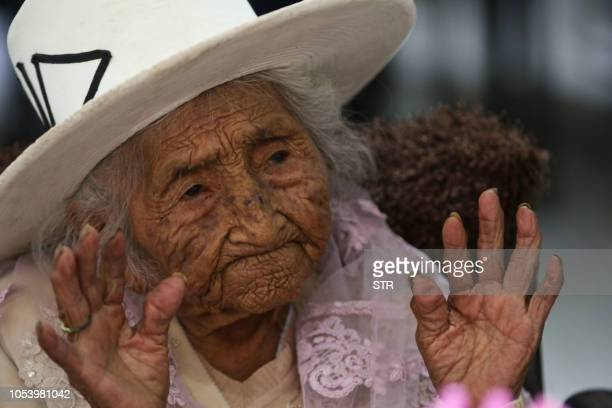 Bolivian Julia Flores Colque known as Mama Julia gestures as she celebrates her 118th birthday in Sacaba Cochabamba department Bolivia on October 26...