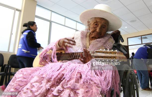 Bolivian Julia Flores Colque known as Mama Julia plays the charango Andean stringed instrument as she celebrates her 118th birthday in Sacaba...