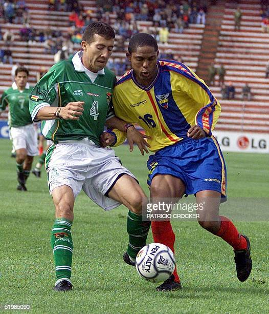 Bolivian Luis Reyes and Ecuadorian Ulises de la Cruz fight for the ball at the Hernando Siles stadium in La Paz Bolivia 06 October 2001 during their...