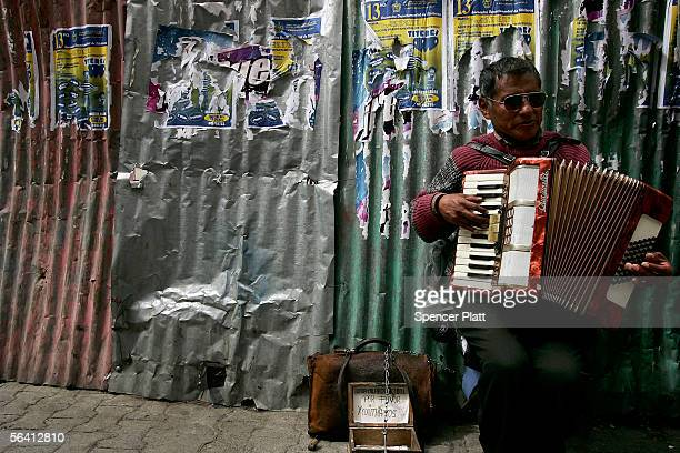 Bolivian man plays the accordion for money on the street December 10 2005 in La Paz Bolivia Bolivia South America's poorest country is about to face...