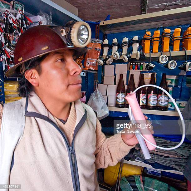 CONTENT] Bolivian miner buying Dynamite sticks fuses blasting caps and Ammonium Nitrate mix at a grocery store in the mining town of Potosi A stick...