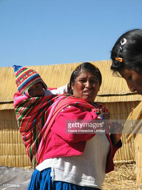 Bolivian mother and baby on the 'Floating Islands', Lake Titicaca.