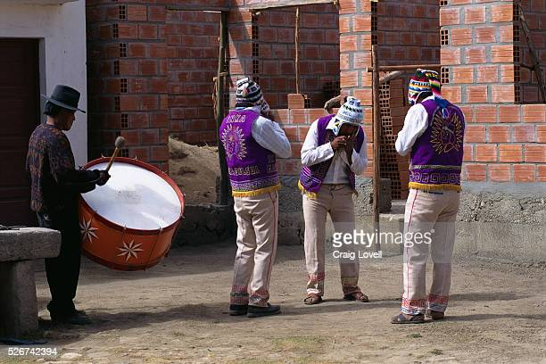 Bolivian musicians playing Zampona panpipe flutes and a Bombo drum on the Isle of the Sun in Lake Titicaca