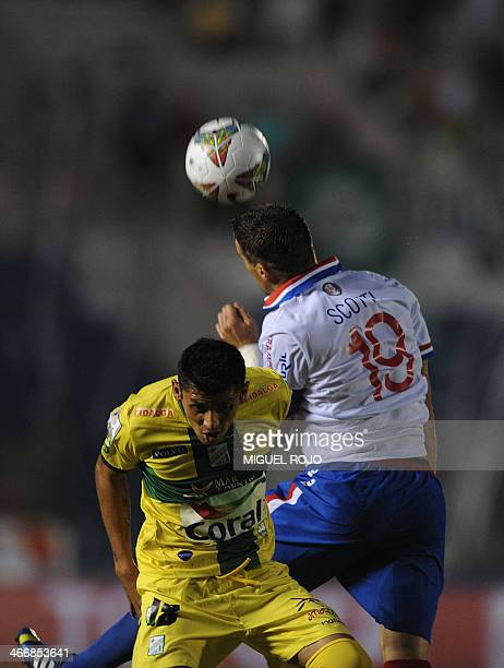 Bolivian Oriente Petrolero's Yasmani Duk vies for the ball with Andres Scotti of Uruguayan Nacional during their Libertadores Cup football match at...