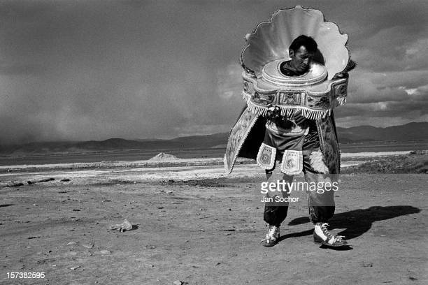 A Bolivian peasant wearing a heavy costume dances on a vast mountain plateau during the festival of Our Lady of Mount Carmel Oruro Bolivia 17 July...
