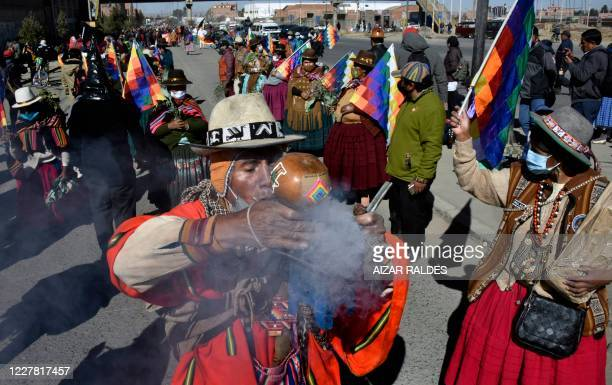 Bolivian peasants and indigenous people, supporters of former Bolivian president Evo Morales, take part in a protest against a second postponement of...