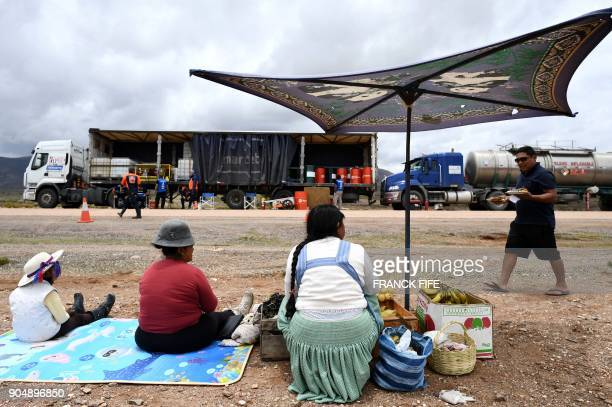 TOPSHOT Bolivian peasants sell fruits in the bivouac at the end of the Stage 8 of the Dakar 2018 between Uyuni and Tupiza Bolivia on January 14 2018...