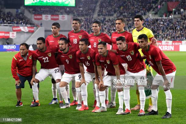 Bolivian players line up for the team photos prior to the international friendly match between Japan and Bolivia at Noevir Stadium Kobe on March 26...