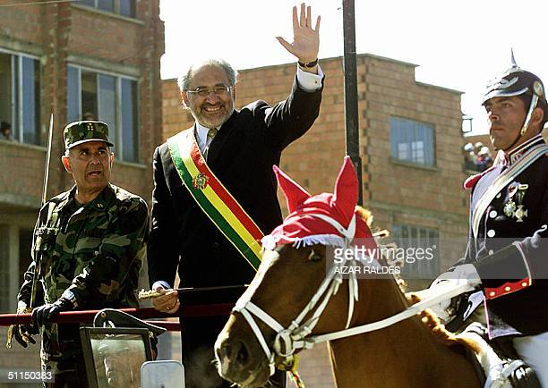 Bolivian President Carlos Mesa waves next to Armed Forces Commander in Chief Luis Aranda during the 179th independence anniversary commemoration 07...