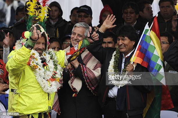 Bolivian President Evo Morales and Vice President Alvaro Garcia Linera greet Bolivian driver Walter Nosiglia of MEC TeamHonda at the end of the Stage...