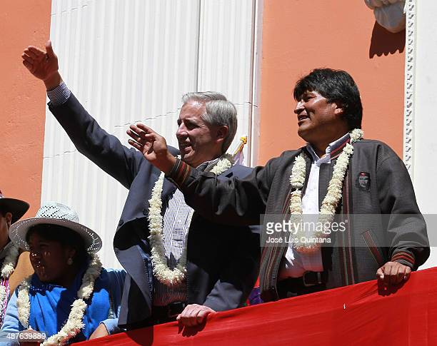 Bolivian President Evo Morales and Vice President Álvaro García Linera greet tje crowds as they watch the International Workers Day parade during...