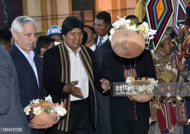 Bolivian President Evo Morales Ayma and VicePresident Alvaro Garcia Linera take part in an Andean ritual during the inauguration of the new...