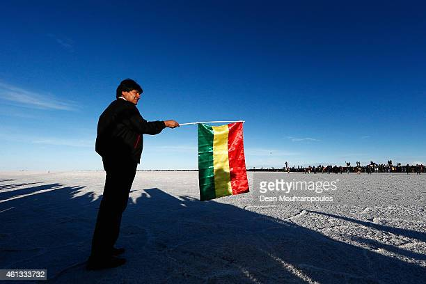 Bolivian President Evo Morales Ayma gets ready to wave a Bolivia flag to start the race during day 8 of the Dakar Rallly on the Salar de Uyuni or...