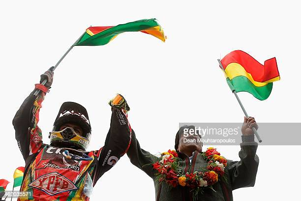 Bolivian President Evo Morales Ayma raises the hand of Juan Carlos Salvatierra of Bolivia for Speedbrain Rally Team on the podium during Day 8 of the...