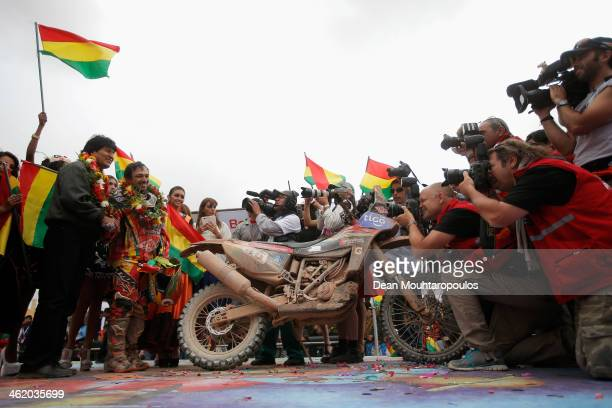 Bolivian President Evo Morales Ayma shakes the hand of Juan Carlos Salvatierra of Bolivia for Speedbrain Rally Team for the photographers on the...