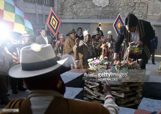 Bolivian President Evo Morales Ayma takes part in an Andean ritual during the inauguration of the new government palace the 'Casa Grande del Pueblo'...