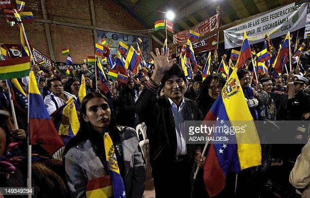 Bolivian President Evo Morales Ayma , waves during a gathering of social movements' members in support of Venezuelan President Hugo Chavez on July...