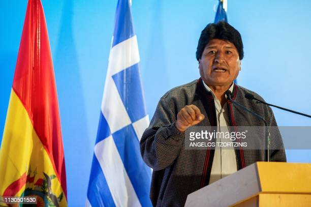 Bolivian President Evo Morales delivers a speech during a conference at the Stavros Niarchos Foundation Cultural Center in Athens on March 14 as part...