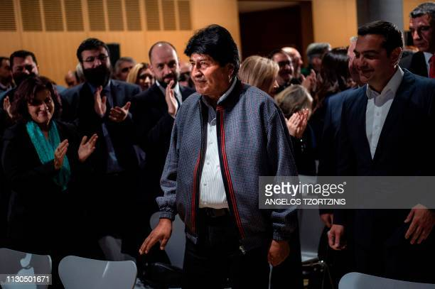 Bolivian President Evo Morales flanked by Greek Prime Minister Alexis Tsipras arrives at the Stavros Niarchos Foundation Cultural Center for a...