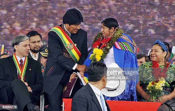 Bolivian President Evo Morales greets Guatemalan Nobel Peace Prize Laureate Rigoberta Menchu alongside Bolivian VicePresident Alvaro Garcia during an...