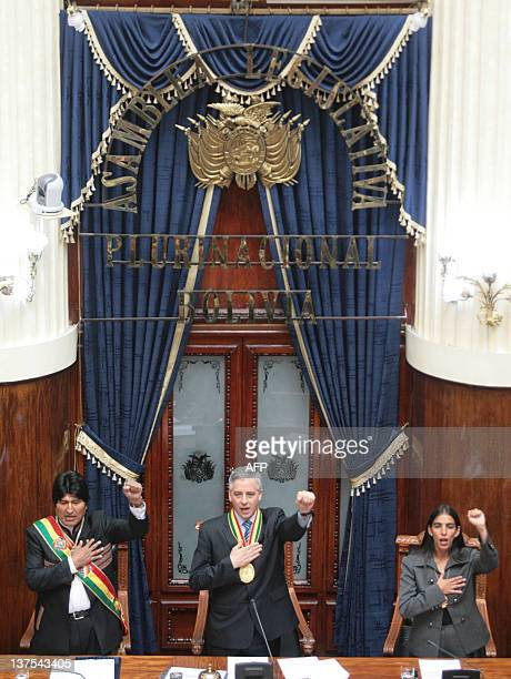 Bolivian President Evo Morales , his Vice President Alvaro Garcia Linera and the President of the Senate, Gabriela Montan, sing the national anthem...