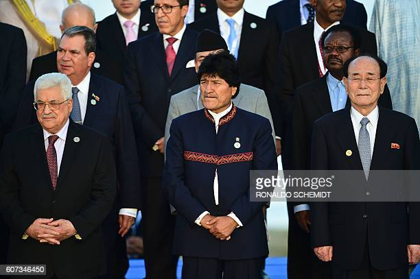 Bolivian President Evo Morales , North Korea's nominal head of state Kim Yong Nam and Palestinian President Mahmoud Abbas pose during the photo...