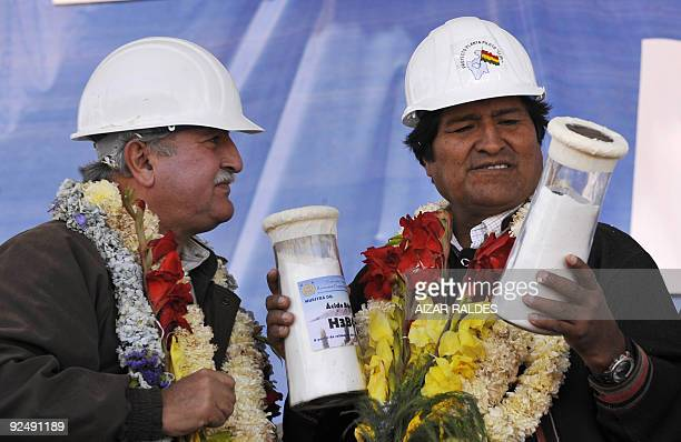Bolivian President Evo Morales receives from Mining Minister Roberto Echazu the first laboratory samples of lithium carbonate a compound used in...