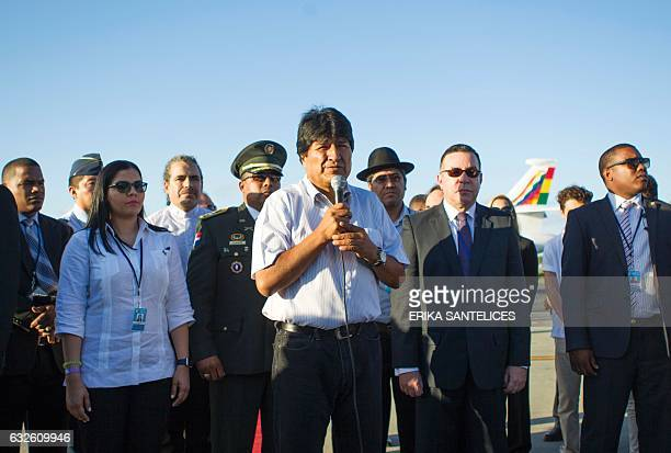 Bolivian President Evo Morales says some words upon arriving at Punta Cana airport in the Dominican Republic on January 24 to participate in the...