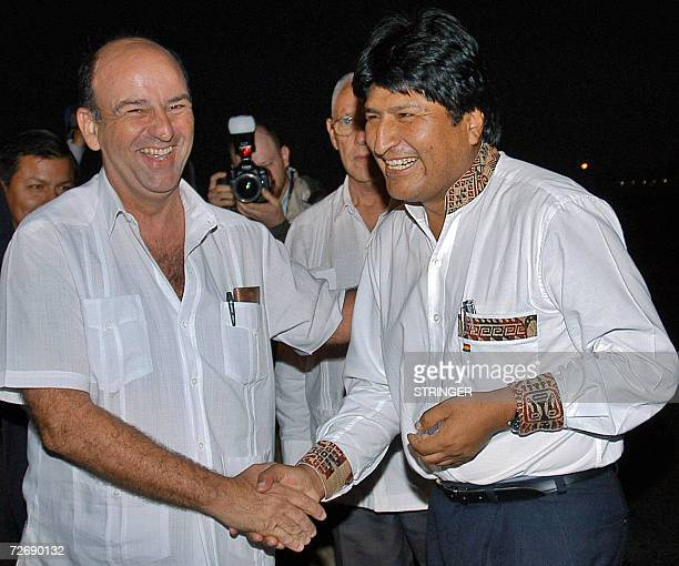 Bolivian President Evo Morales shakes hands with Cuban VicePresident Carlos Lage as he arrives in Cuba to take part on the celebrations for the 80th...