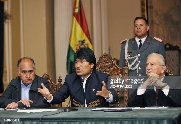 Bolivian President Evo Morales speaks next to his Mining Ministry José Pimentel and Luis Alberto Echazú Manager of the Uyuni salt flat during a press...